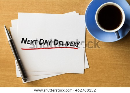 Next day delivery - handwriting on papers with cup of coffee and pen, business concept