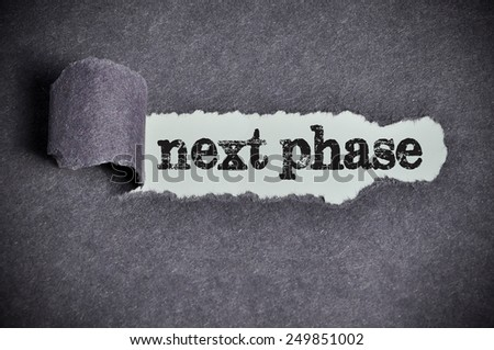 next phase word under torn black sugar paper  - stock photo