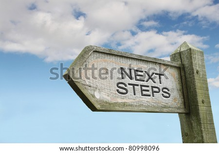 Next Steps Old Wooden Sign - stock photo