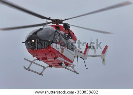 Nezhin, Ukraine - January 14, 2011: Ukrainian Ministry of Emergency Situations Eurocopter EC145 (BK-117) rescue helicopter in flight - stock photo