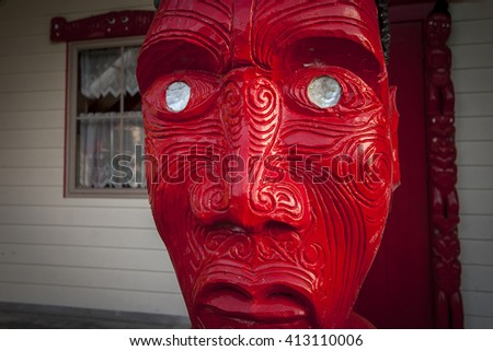 NGARUAWAHIA - OCTOBER 02: Exterior view of colourful carvings on a Maori meeting house (Marae) on October 02 2008 in Ngaruawahia, New Zealand. - stock photo