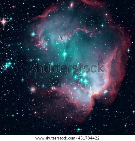 NGC 602 (N90) is a young open cluster of stars located in the Small Magellanic Cloud, a satellite galaxy to the Milky Way. Elements of this image furnished by NASA.