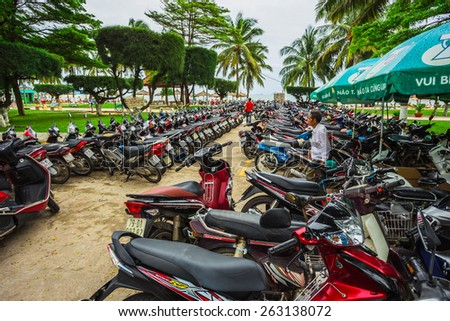 NHA TRANG, Vietnam - NOV 22, 2014: Motorcycles of many brands parking on a street side of NHA TRANG capital. Motorcycle is the most popular vehicle in Vietnam. - stock photo