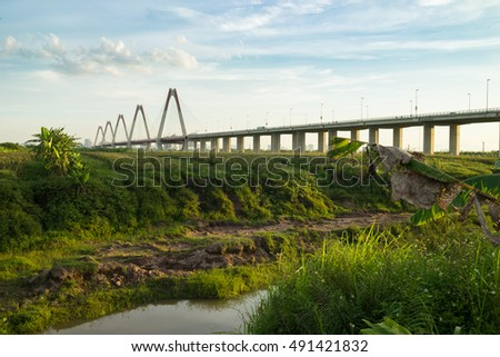 Nhat Tan bridge viewing from wild land on Red River riverbed