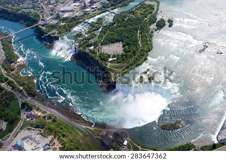 Niagara Falls American and Canadian side above view from Helicopter - stock photo