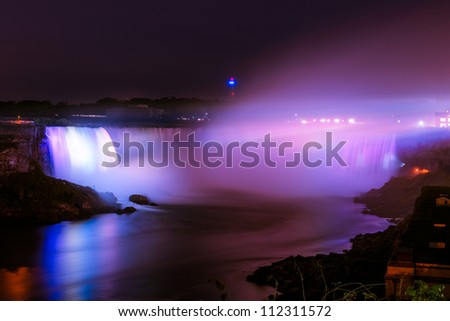 Niagara Falls illuminated colored lights at night - stock photo