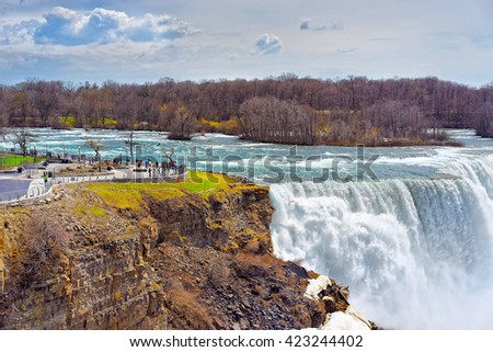 Niagara Falls viewed by tourists from American side. A view on American Falls