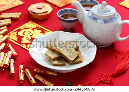 nian gao, chinese new year rice cake, pan fried and dipped in egg - stock photo
