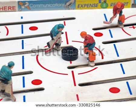 NICA, LATVIA - OCTOBER 23, 2015: Table hockey is one of most popular board games for relaxation and fun in winter season. - stock photo