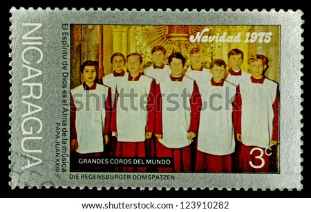 "NICARAGUA - CIRCA 1975: A stamp printed in Nicaragua shows a Regensburg Cathedral choir, with the same inscription, from the series ""Christmas. Famous Choirs"", circa 1975"