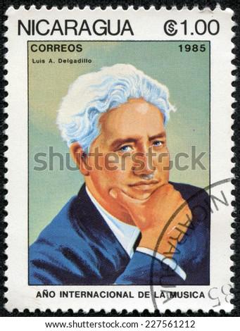 NICARAGUA - CIRCA 1985: A stamp printed in Nicaragua shows Luis A. Delgadillo (1887-1961), series International Music Year, circa 1985 - stock photo