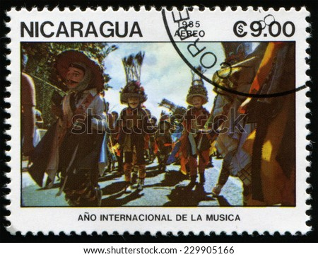 NICARAGUA - CIRCA 1985: a stamp printed in Nicaragua shows Music festival on the streets of Nicaragua. Year of international music, circa 1985 - stock photo