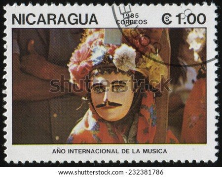 NICARAGUA - CIRCA 1985: a stamp printed in Nicaragua shows Music festival on the streets of Nicaragua. Year international music, circa 1985 - stock photo