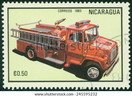 NICARAGUA - CIRCA 1983: a stamp printed in Nicaragua shows red fire truck,series, circa 1983 - stock photo