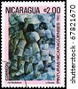 "NICARAGUA - CIRCA 1982: A Stamp printed in NICARAGUA shows the painting ""Street Vendors"" of the artist L.Cerrato, from the series ""Paintings"", circa 1982 - stock photo"