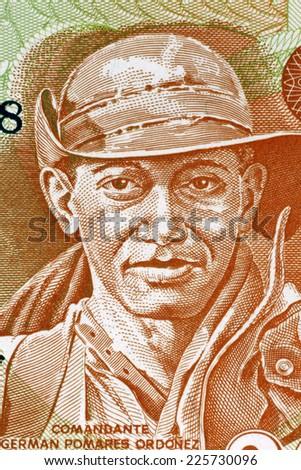 NICARAGUA - CIRCA 1979: German Pomares Ordonez (1937-1979) on 20 Cordobas 1979 Banknote from Nicaragua. Nicaraguan revolutionary and National Hero. - stock photo