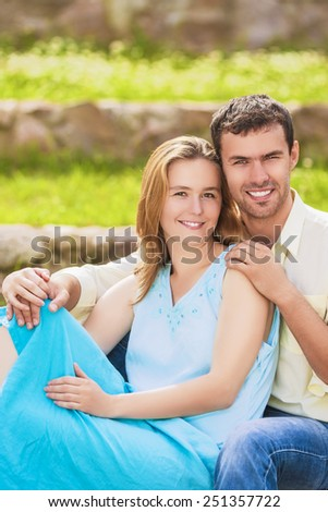Nice and Beautiful Caucasian Couple Having Great Time Together and Sitting Embraced. Horizontal Image - stock photo