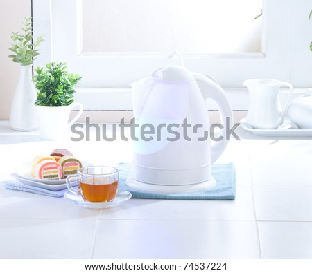 Nice and clean kettle in the hygiene kitchen - stock photo