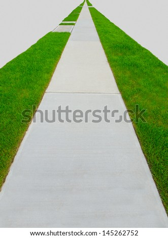Nice and clean long, strait sidewalk, path to nowhere. On