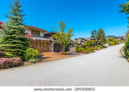 Nice and comfortable great neighborhood. Some homes on the empty street in the suburbs of Vancouver, Canada. - stock photo