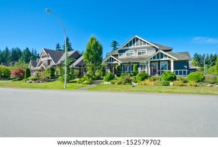 Nice and comfortable neighborhood. Empty street with a row ...