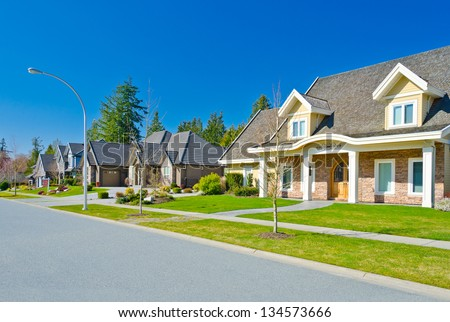 Nice and comfortable neighborhood. Some homes in the suburbs of the North America. Canada. Suburban housing community - stock photo