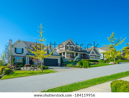 Nice and comfortable neighborhood. Some homes up the hill on the empty street in the suburbs of Vancouver. Canada. - stock photo