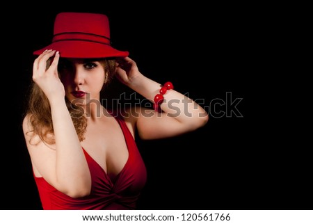 Nice and elegant young woman with a red hat. - stock photo