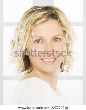 Nice and happy 40 years old woman - stock photo