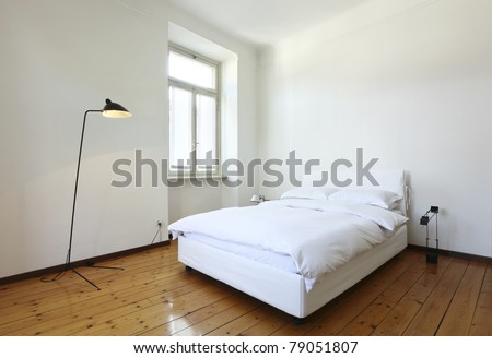 nice apartment refitted, bedroom with a double bed and lamps