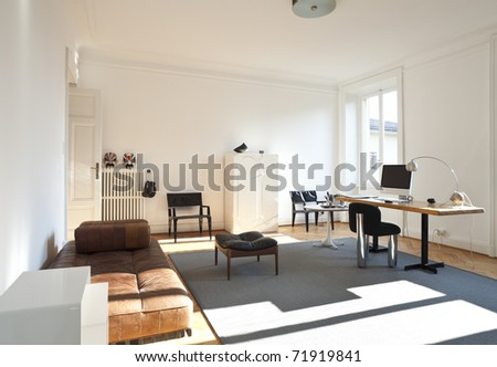 nice apartment refitted, studio room with furniture retro - stock photo