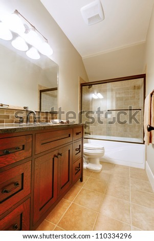 Nice bathroom with wood luxury cabinet and ceramic tile. - stock photo