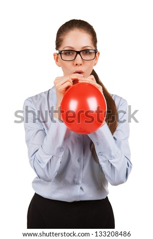 Nice beautiful business woman in glasses inflates a red ball
