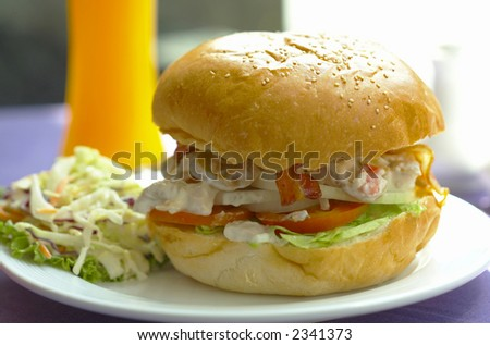 nice big delicious sandwich with beckon,  vegetable and beef - stock photo