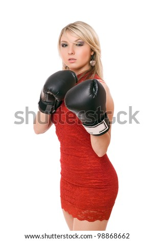 Nice blond young woman in boxing gloves
