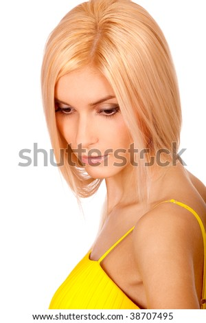 Nice blonde has hung head and thinks of life, it is isolated on white background.