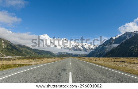 Nice blue sky and cloudy day. Road to Aoraki - Mount Cook, Southern Alps, New Zealand - stock photo
