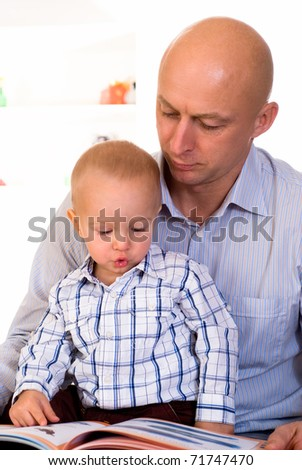 nice boy and his father on a white background - stock photo