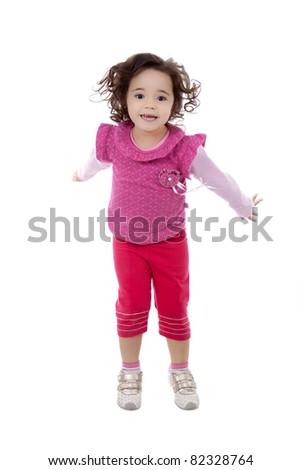 Nice brazilian child girl jumping, isolated on white. - stock photo