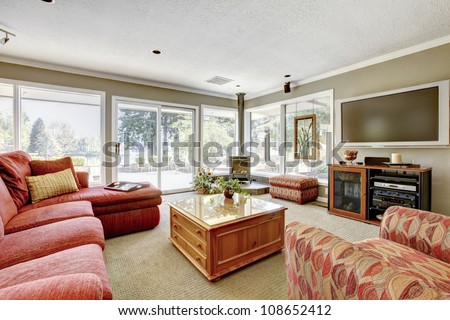 Nice bright living room with Tv and red sofa. - stock photo