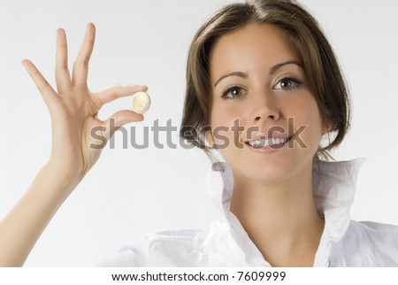 nice brunette with one euro between the finger - stock photo