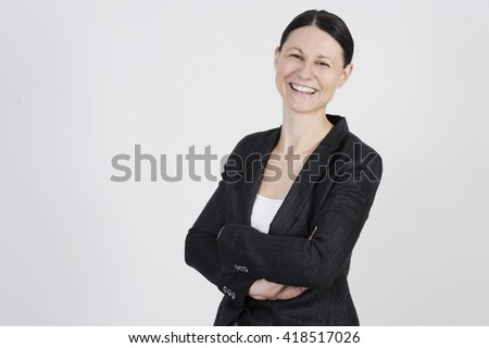 Nice business woman in the office with copy space waiting the new colleagues - stock photo