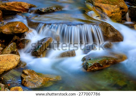 Nice cascade of mountain waterfall - stock photo