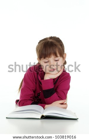 Nice Caucasian young girl lying with a book on a white background