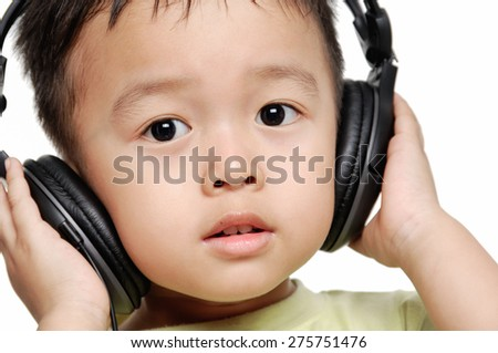 Nice child listening music - stock photo