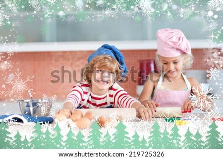 Nice children baking in a kitchen against snow - stock photo