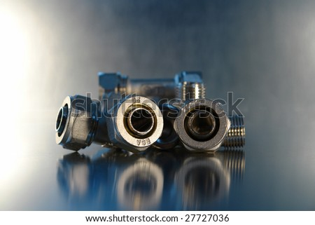 Nice chrome fittings with a nice reflection - stock photo