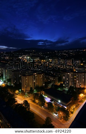 Nice cityscape at night with blue sky