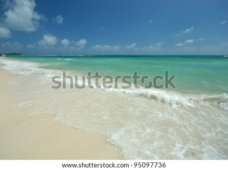 Nice clear beach in bright blue sky day.