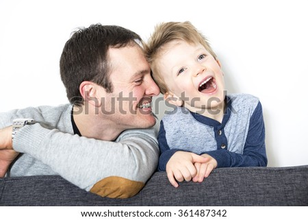 nice closeup of father and son at home  - stock photo